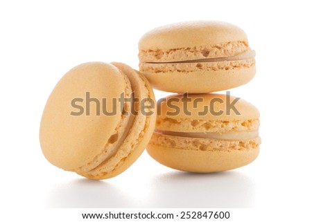 Colorful French Macarons on the white background. - stock photo