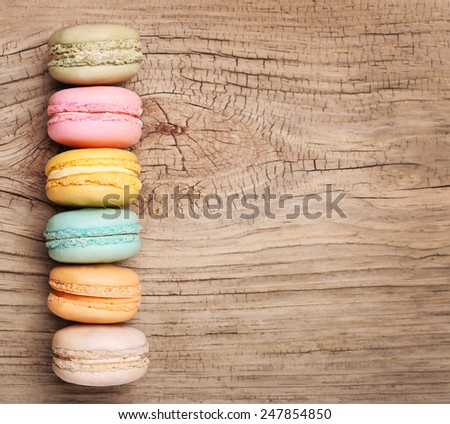 Colorful French Macaroon on wooden background - stock photo