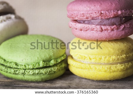 Colorful French macaroons on a dark  wooden background - stock photo