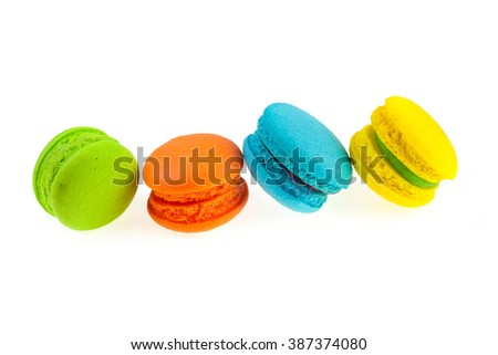 Colorful french macaroons on a white background.