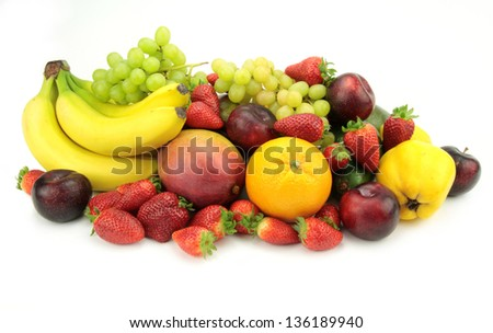 Colorful fresh fruits on white background. - stock photo