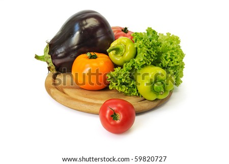 Colorful fresh group of vegetables on a wooden board. White background - stock photo