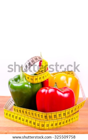 Colorful fresh paprika and measuring tape, Diet concept