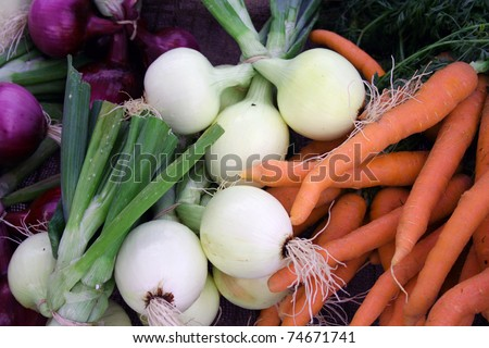 Colorful fresh vegetables carrots and onions at farmer?s market - stock photo
