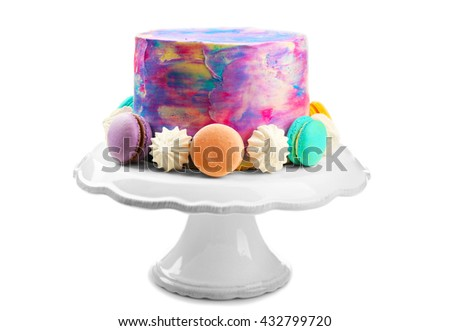 Colorful frosted cake on white background - stock photo