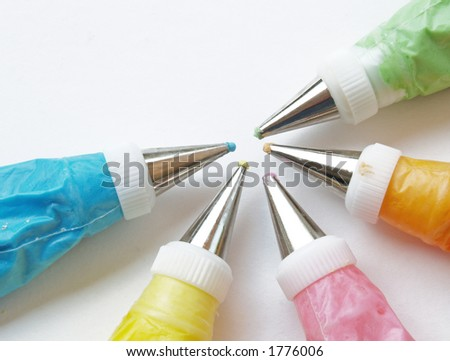 colorful frosting ready to decorate cakes or cookies - stock photo