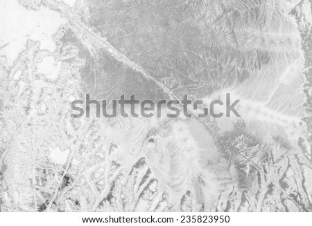 Colorful frozen window with ice and snowflakes - stock photo