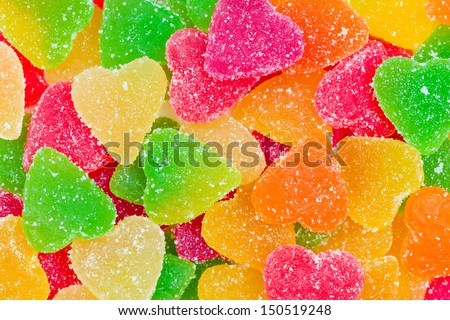 Colorful fruit candy in sugar in the form of hearts - stock photo