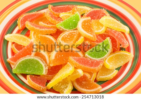 colorful fruit jelly candies on dish - stock photo
