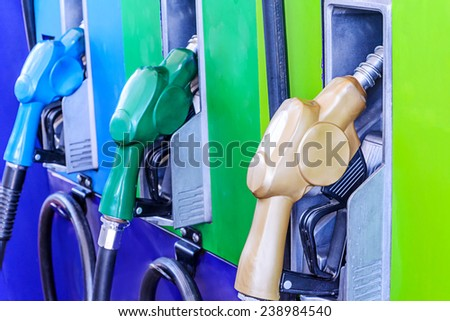 Colorful fuel oil gasoline dispenser at gas station. - stock photo
