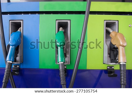 Colorful fuel oil gasoline dispenser at petrol filling station - stock photo