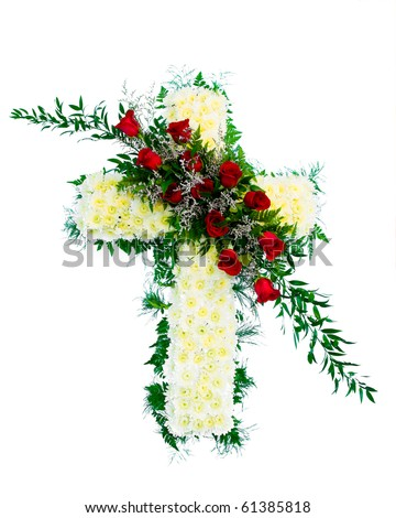 Colorful funeral flower arrangement with Cross design.