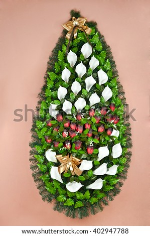Colorful funeral flower arrangement wreath for funerals wreaths with design - stock photo