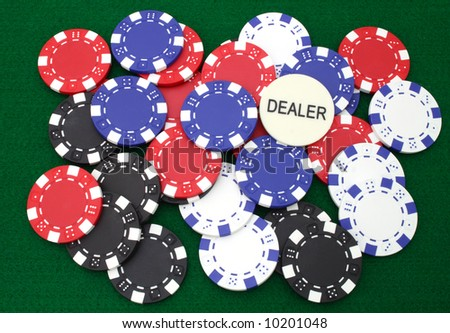 colorful gambling chips over a green table