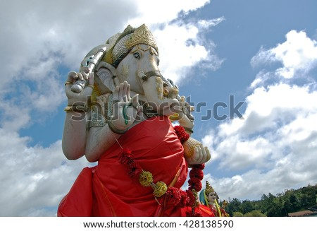 Colorful Ganesha statue on sky background at Grand Bassin, Mauritius - stock photo