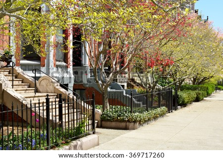 Colorful gardens and Victorian facades in Back Bay, Boston - stock photo