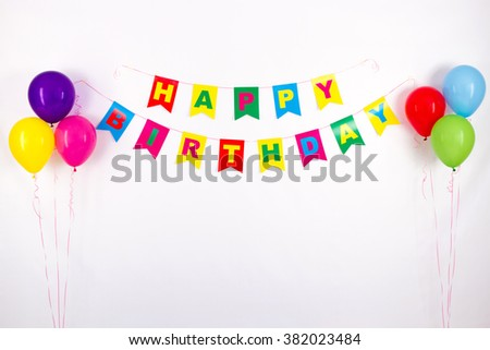 colorful garlands, streamer, party hats and confetti. festive decoration background with sample - stock photo