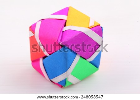 Colorful Geometric Origami Ball isolated on white background