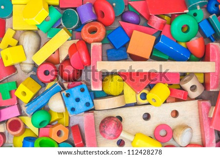 colorful geometric wood toy for children random top view - stock photo