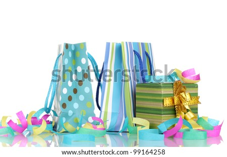 Colorful gift bags and gifts  with serpentine isolated on white - stock photo