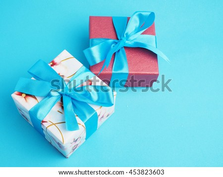 Colorful gift box in important day on blue background style, top view.