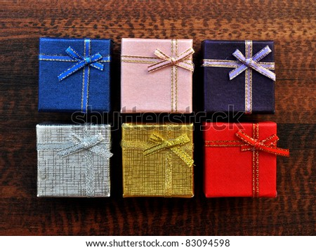 Colorful gift box top texture on table background - stock photo