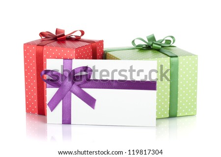 Colorful gift boxes and letter with ribbon and bow. Isolated on white background - stock photo