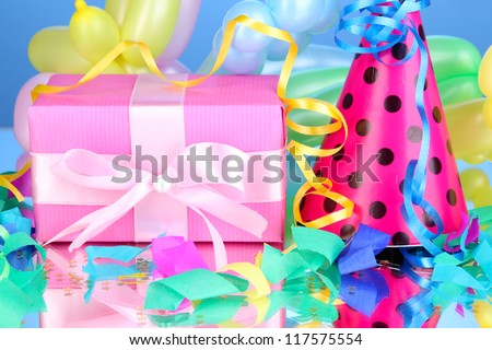 Colorful gift boxes on blue background - stock photo