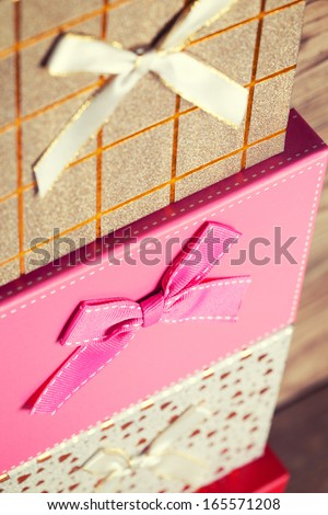 colorful gift boxes on wooden background