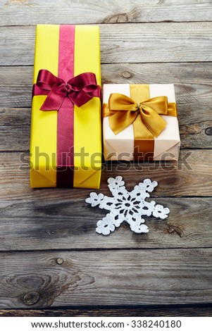 colorful gift boxes with bows and snowflakes  over wooden background.  - stock photo