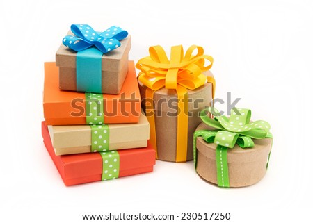 Colorful gift boxes with ribbons on white background