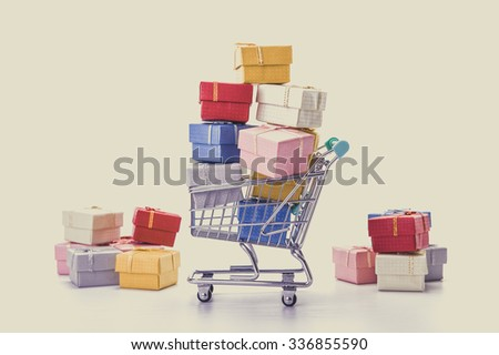 colorful gifts box,supermarket shopping cart  - stock photo