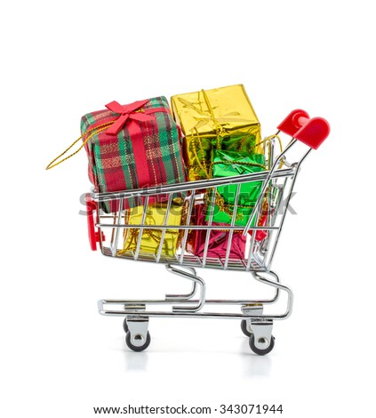colorful gifts box,supermarket shopping cart on white background - stock photo