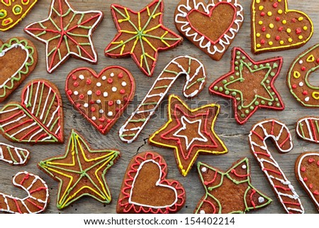 Colorful gingerbread cookies on wooden background - stock photo
