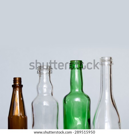 Colorful glass bottles. brown, green, transparent. gray background. copy space