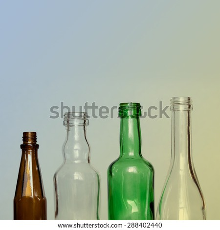 Colorful glass bottles. brown, green, transparent. retro effect background. copy space