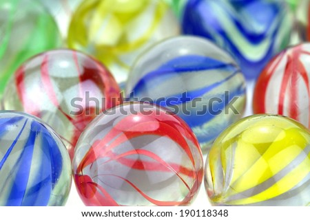 Colorful glass marbles. Macro image. - stock photo