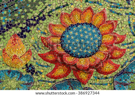 Colorful glass mosaic art shape lotus and abstract wall background.