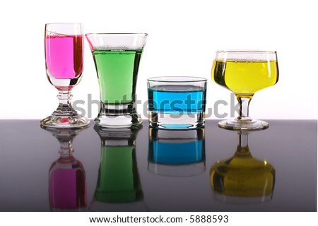 Colorful glasses in a row against white background. - stock photo