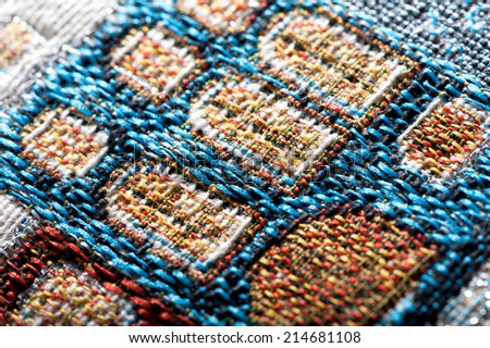 colorful gobelin tapestry texture close-up background - stock photo