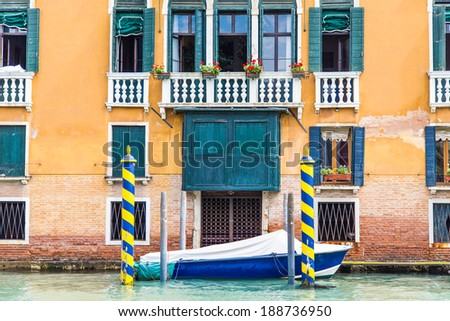 Colorful gondola posts in a Venice canal