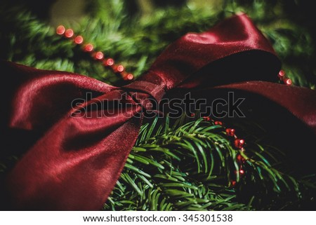 colorful gorgeous beautiful christmas bow on  the fir wreath for winter holidays - stock photo
