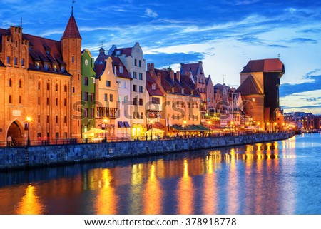 Colorful gothic facades facing Wisla River in the old town of Gdansk, Poland, in the late evening - stock photo