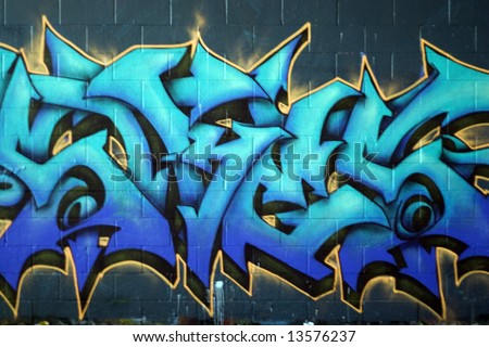 Colorful graffiti spray painted on a brick wall - makes a great background or backdrop. - stock photo