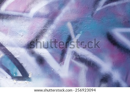 Colorful graffiti wall with spray a paint. Blue background. - stock photo