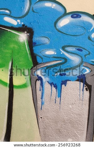 Colorful graffiti wall with spray a paint. Blue, grey and green background. Urban art. - stock photo