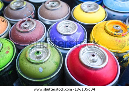colorful graffitty spray cans - stock photo