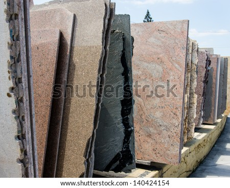 Colorful granite slabs for sale in store show room - stock photo