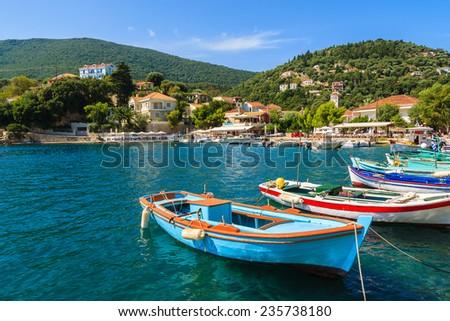 Colorful Greek fishing boats in port of Kioni on Ithaka island, Greece  - stock photo