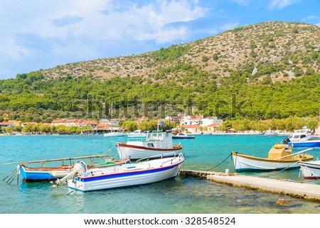Colorful Greek fishing boats on shore in Posidonio bay, Samos island, Greece - stock photo